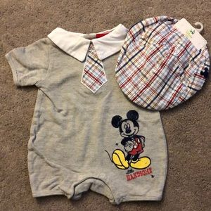 Mickey Mouse one piece with matching hat.
